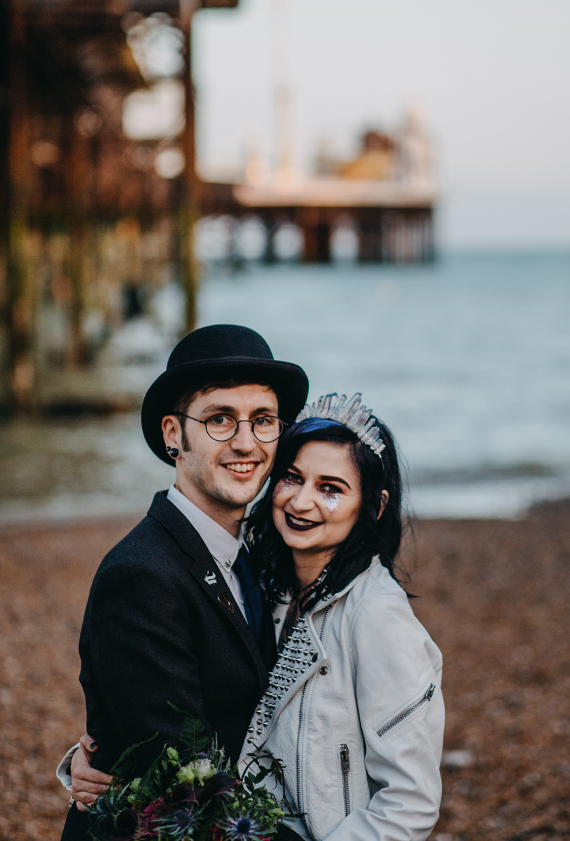 alternative goth couple at sunset on brighton beach for their alternative rock n roll wedding by lex fleming photo