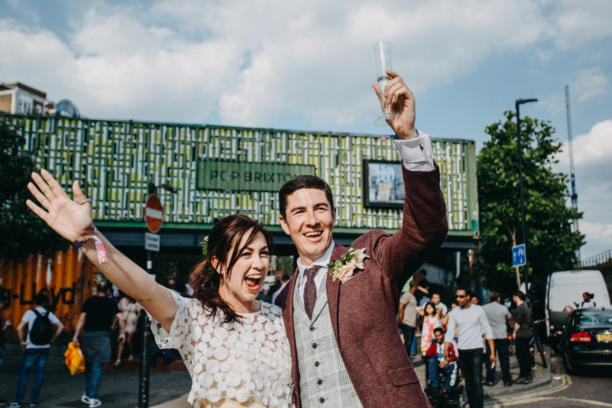 summer pop brixton wedding couple outside of pop brixton for their summer july wedding