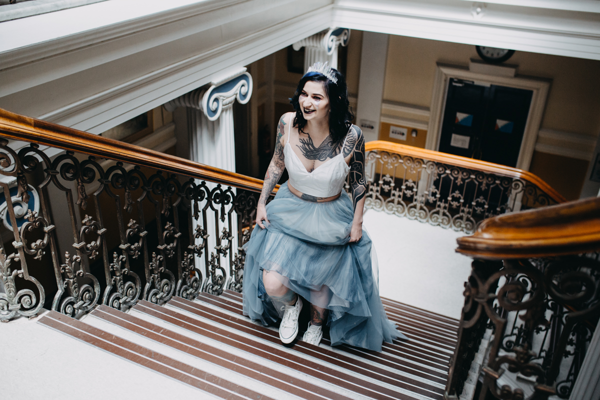 tattooed bride arriving at brighton town hall for alternative tattoo skater wedding