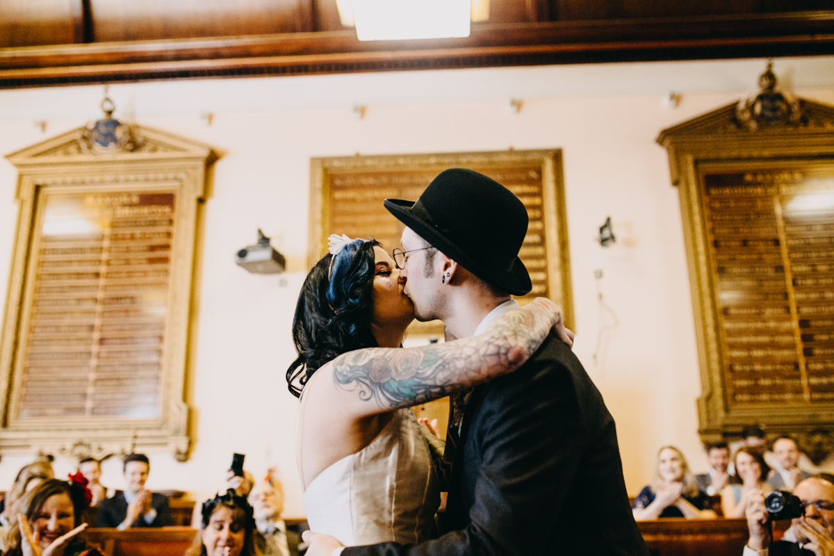 alternative tattooed couple first kiss