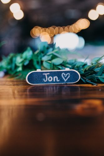 mini skateboard wedding favours during tattoo skater wedding in brighton