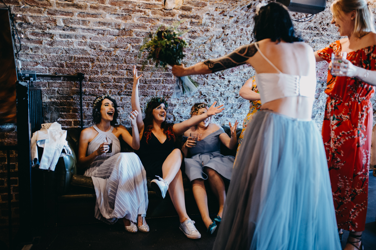 candid wedding photography bridesmaids singing at alternative skater wedding in brighton